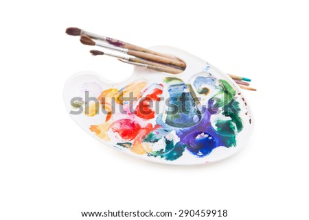 Heavy used artist's palette with brushes  - stock photo