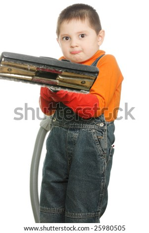 Heavy vacuum cleaner in little boy's hand photo over white - stock photo