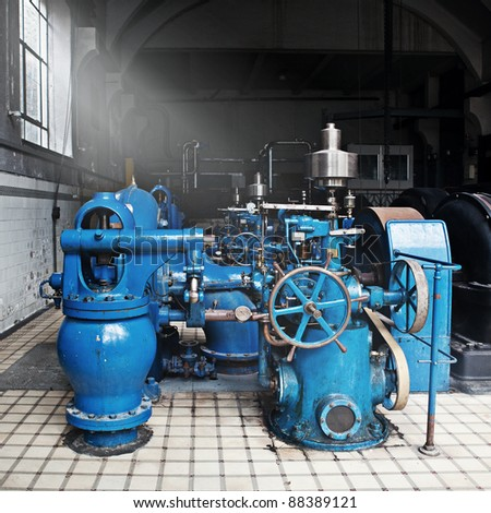 Heavy water pumping machinery in vintage industrial water cleaning station - stock photo
