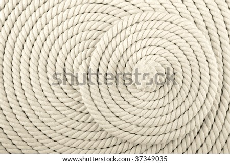 Heavy, white coiled rope. - stock photo