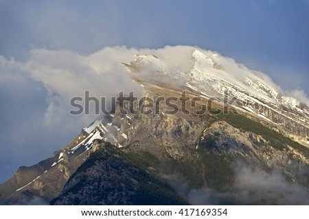 Heavy winds on Mt Rundle, Banff National Park, Alberta, Canada - stock photo