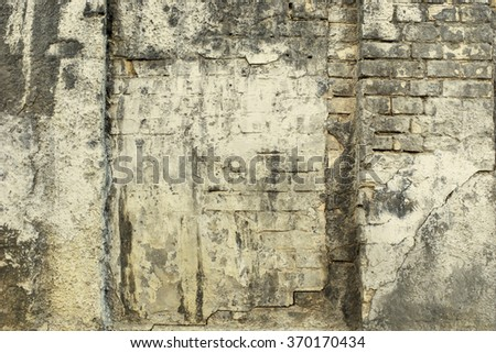 Heavy worn black brick painted building wall texture background. Vintage effect.  - stock photo