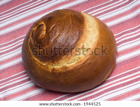 Hebrew Spiral Challah Loaf of Bread  on Colorful Cloth - stock photo