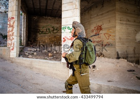 Hebron, Israel (West Bank) - May 23, 2014: IDF soldiers on the Palestinian side of the divided city of Hebron in the West Bank.