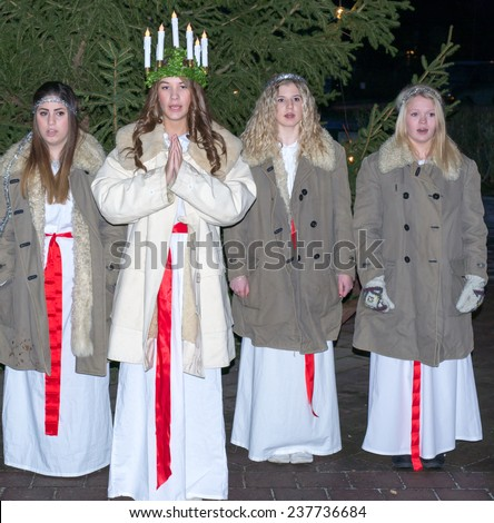 HEBY, SWEDEN - DECEMBER 13: Undentified people in Santa Lucia at Christmas celebration in Heby city on December 13, 2014 in Heby Sweden - stock photo