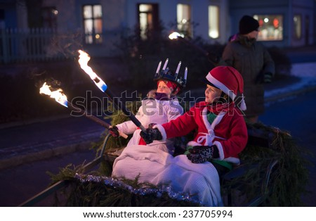 HEBY, SWEDEN - DECEMBER 13: Unidentified people in Santa Lucia at Christmas celebration in Heby city on December 13, 2014 in Heby Sweden - stock photo