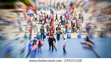 Hectic in the city - people in a town with zoom effect - stock photo