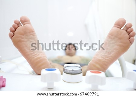 Heels lying person in the bath on the procedures