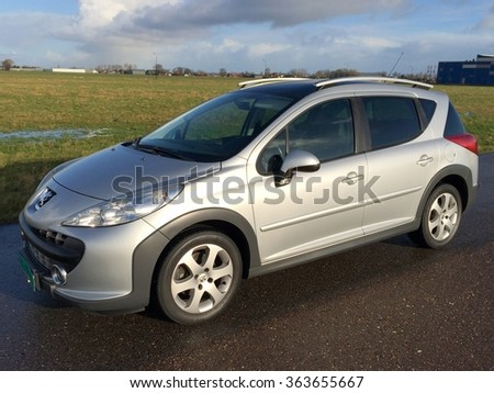 Heerhugowaard, The Netherlands - Januari 16, 2016: Gray Peugeot 207 SW (break) Sport Outdoor arked by the side of the road.
