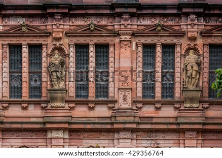 Heidelberg architecture, historic windows and statues