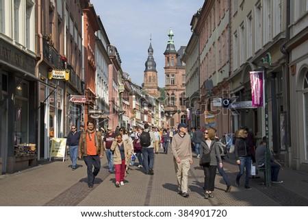 Heidelberg, Germany - April 30, 2014: People walk in the Heidelberg mainstreet among shops in the historic center of Heidelberg, Germany on April 30, 2014 - stock photo