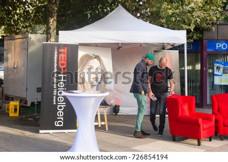 HEIDELBERG GERMANY - October 1st 2017. Two young unidentified men promote an TEDx event : heidelberg tents - memphite.com