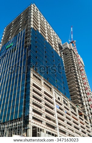Height building with blue sky under construction in Bangkok, Thailand