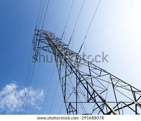 Height voltage tower line on the cloudy sky background.