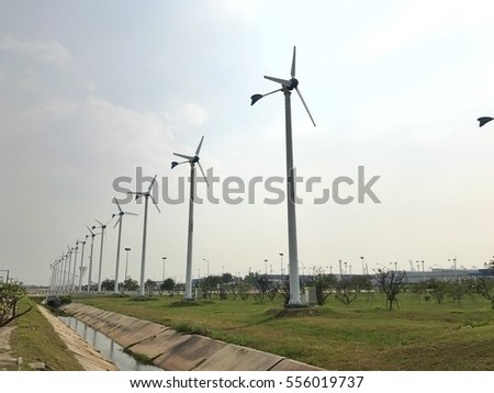 Height wind turbine  on green grass for clean power generator