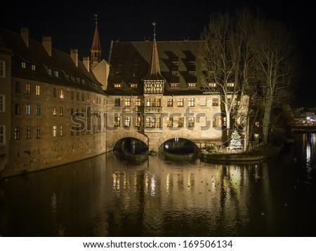 Heilig Geist Spital in Nuremberg Germany at night - stock photo