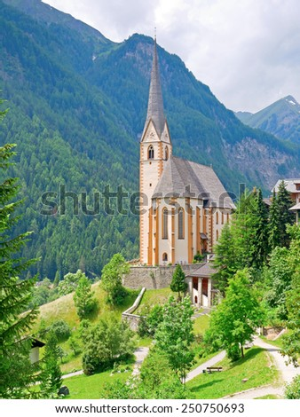 HEILIGENBLUT, AUSTRIA - 27 June 2014: The gothic pilgrimage church of Heiligenblut is a landmark in Carinthia.