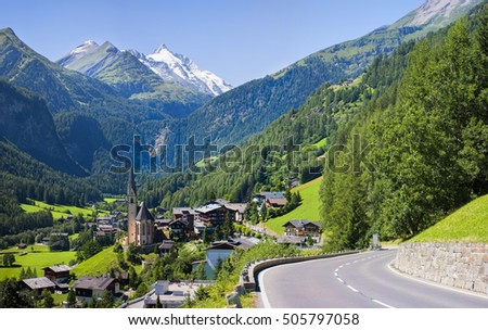 Heiligenblut church in Austria with Grossglockner peak in background