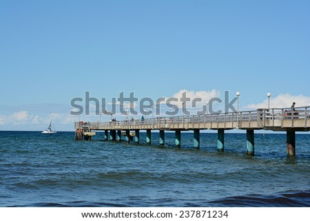 HEILIGENDAMM, GERMANY - August 27, 2014: pier in Heiligendamm on the Baltic Sea with tourists on a windy summer day