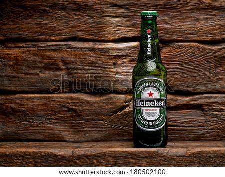 Heineken Lager Beer bottle on wooden background. TURKEY - March 6, 2014