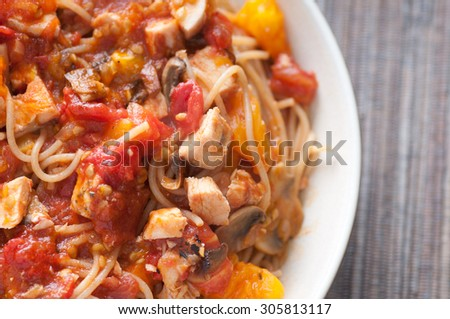 heirloom tomato pasta with grilled chicken on spaghettini noodles