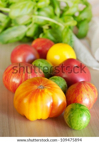 Heirloom tomatoes and basil - stock photo