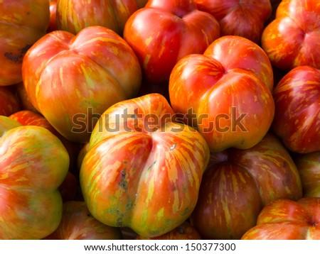 Heirloom tomatoes at local farm market. - stock photo