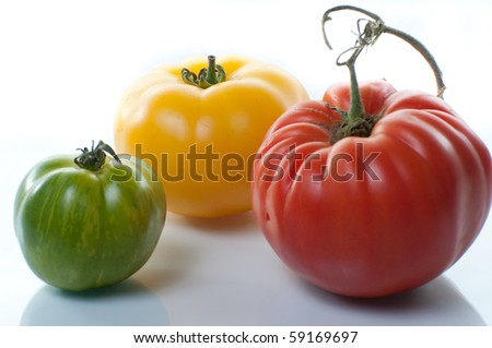 heirloom tomatoes isolated on white - stock photo