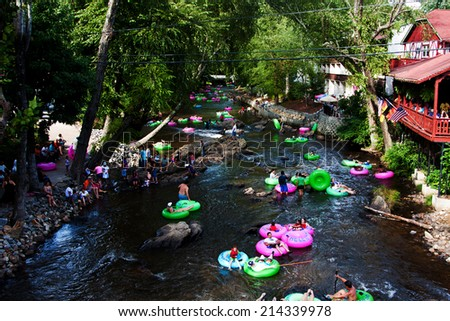Helen, GA, USA - Aug. 31 2014: Tourist tubing the lazy river Chattahoochee in Alpine Helen, GA. - stock photo