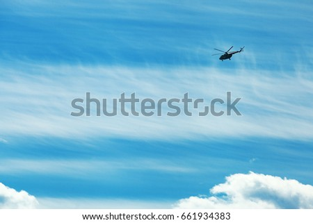 Helicopter above the clouds