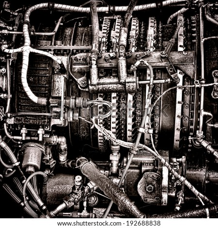 Helicopter aircraft turbine engine hydraulic fuel intake management command system inside panel with valves and tubing controlled by electrical connectors and electric relays in grunge sepia - stock photo
