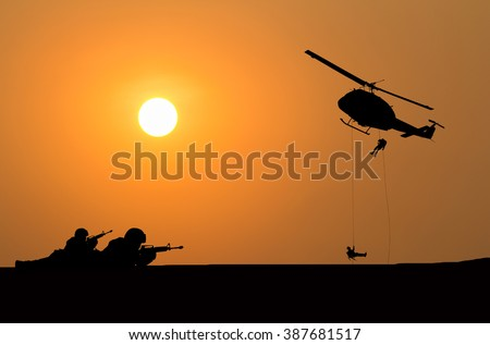 helicopter and soldier silhouette