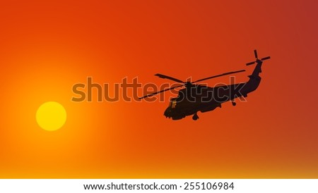 Helicopter at sunset. Fly to the sun. Beautiful sky.  Red glow. crimson decline.