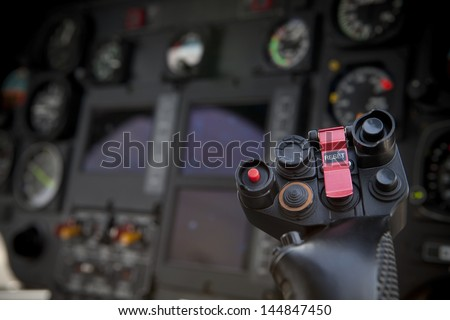 helicopter control stick in side pilot cockpit - stock photo