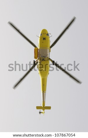 Helicopter fire fighting, seen from below - stock photo