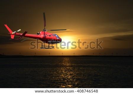 Helicopter Flying at sunrise - stock photo