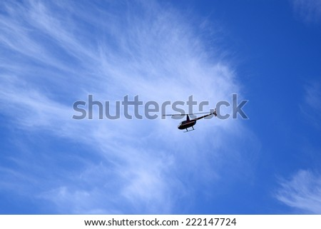 Helicopter in a blue sky - stock photo