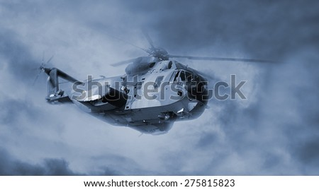 helicopter in flight with cloudy sky