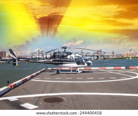 Helicopter in lower Manhattan, ready to hover over New York. - stock photo