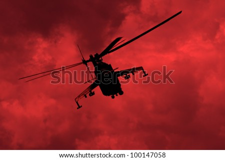 Helicopter in the red sky - stock photo