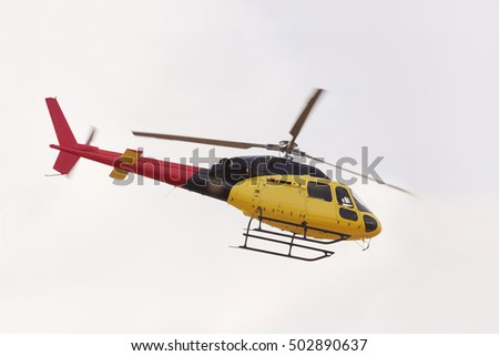 Helicopter in white sky background