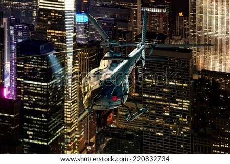 Helicopter night flight between the skyscrapers of New York Manhattan district - stock photo