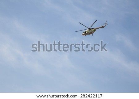 Helicopter on a blue sky