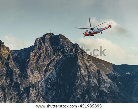 Helicopter on a rescue mission in the Tatras Mountains.