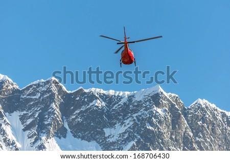 Helicopter on background of the Mahalangur Himal ridge - Everest region, - stock photo