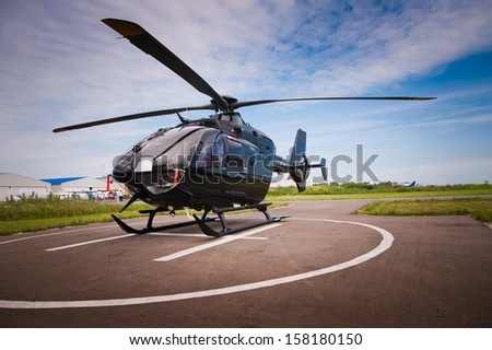 Helicopter parked at the helipad - stock photo