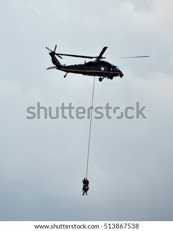 Helicopter performs emergency rescue airlift on outside rope