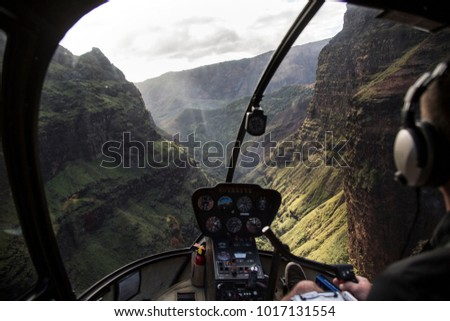 helicopter ride in drmatic deep canyon