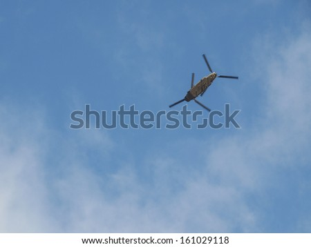 Helicopter rotor craft flying in the sky
