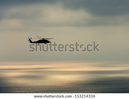 Helicopter Silhouette - stock photo